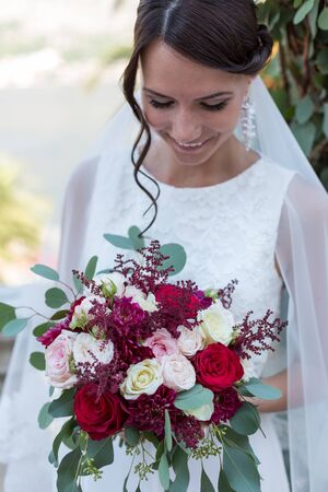 yellow dress: Beautiful young bride outdoors with a bouquet