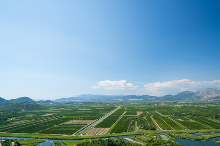 neretva: aerial view of beautiful Neretva valley in southern Croatia with numerous crop fields and hills in distance.