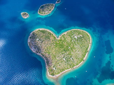romantic places: Aerial view of the heart shaped Galesnjak island on the adriatic coast of Croatia.