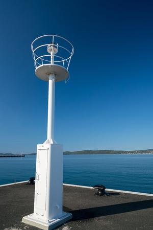 lighthouse in the ferry port Gazenica port in Zadar, Croatia. Stock Photo