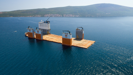 submerging: Tivat, Montenegro - 31 July 2017: Heavy lift vessel Dockwise Vanguard came to Montenegro to take the floating dock Editorial
