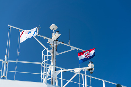 Zadar, Croatia - July 20, 2016: the flag of country and Jadrolinija company at the ferry boat. Editorial