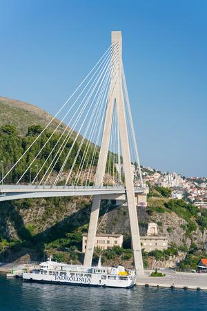 Dubrovnik, Croatia - July 21, 2016: The Jadrolinija ferry under the bridge