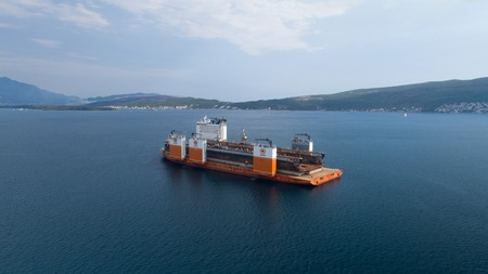 Tivat, Montenegro - 4 August 2017: Heavy lift vessel Dockwise Vanguard came to Montenegro to take the floating dock Editorial