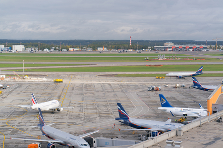 Moscow, Sheremetyevo airport, Russia - September 24, 2016: view of aircraft parking near terminals Editorial