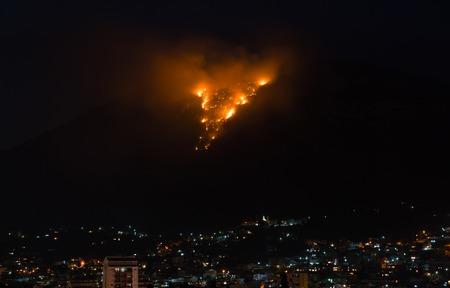 Burning mountain at dusk above the city, Montenegro