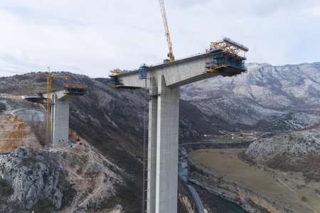 Construction of bridge of a new highway through the Moraca canyon in Montenegro 스톡 콘텐츠