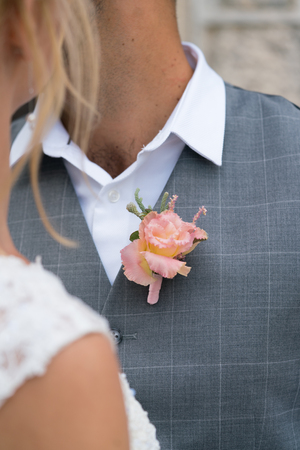 boutonniere on the vest of the groom