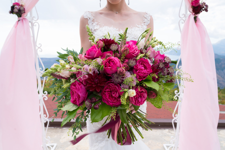 bright bouquet of various red and pink flowers