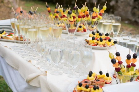 champagne glasses and various snacks for consumption after the wedding ceremony