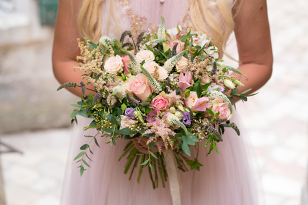 gorgeous rustic wedding bouquet of various flowers and herbs