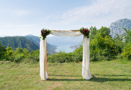 rectangular wedding arch decorated with flowers for the wedding ceremony Stock Photo