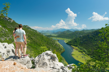 couple enjoying the view of the Crnojevica River, Montenegro Stock Photo