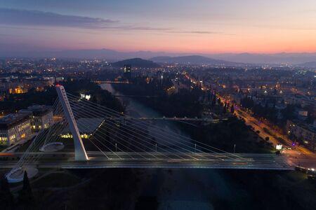 aerial view of Millennium bridge over Moraca river in Podgorica at night