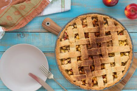 Home-baked lattice apple pie, in a baking dish.