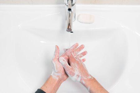 Washing hands rubbing with soap man for coronavirus prevention, hygiene to stop spreading coronavirus.