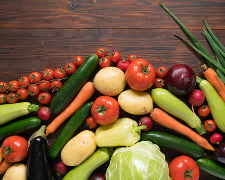 vegetables assortment on dark wooden surface, top view
