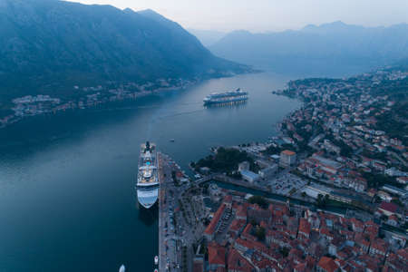 Kotor, Montenegro - October 28, 2019: cruise ships Norwegian Spirit and Norwegian Star are in port, aerial. Éditoriale
