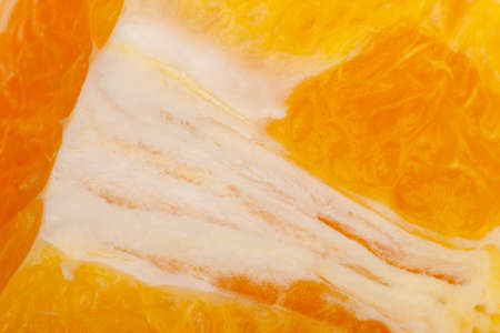 Flesh of juicy ripe orange as background or backdrop close-up Limited depth of field 版權商用圖片
