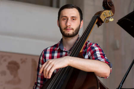 Double bass player playing contrabass Portrait