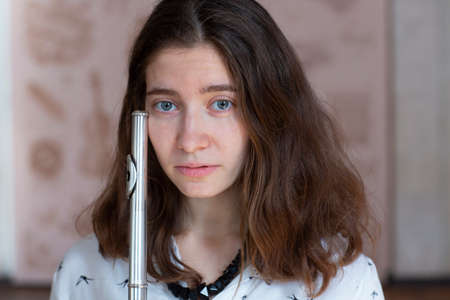 Beautiful young woman with flute Genre portrait of young beautiful girlr Close-up