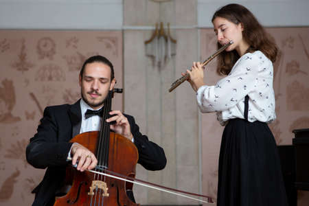 Young musicians of the symphony orchestra Duet Close-up Stock Photo