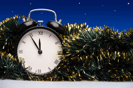 Composition of clock and christmas decorations on bright background. Card