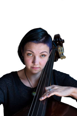 Young positive brunette playing double bass Isolated image on white background. Portrait