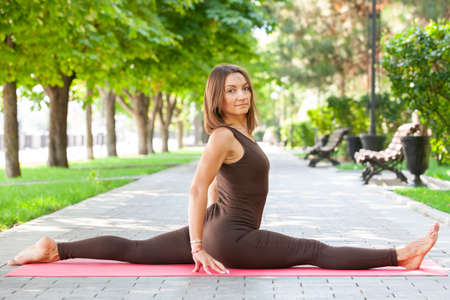 healthy middle aged woman doing fitness stretching outdoors Portrait