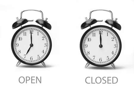 Sign showing business opening hours Black and white image Isolated on white background Close-up
