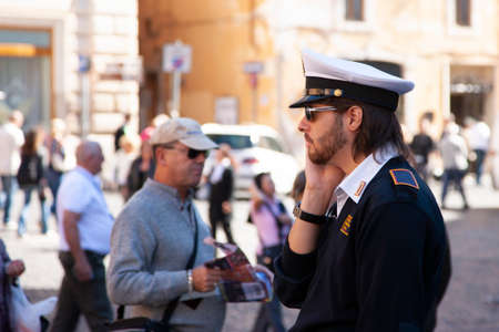 Rome, Italy, October 14, 2011: the policeman helps the tourist Genre