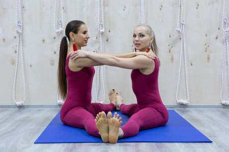 Attractive young sport girls are doing yoga together. Group training. Healthy lifestyle concept. Portrait