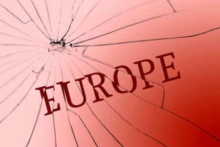 The text Europe on the broken glass. Opposition or racism concept. Close-up 免版税图像