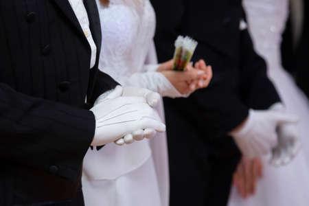 Wedding theme, holding hands newlyweds White gloves Close-up Stock Photo