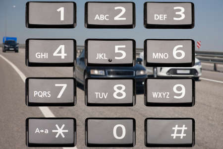 The phone diverts attention from driving. The concept of safe driving. Keyboard phone. Collage Limited depth of field