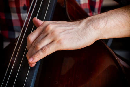 Hand of a musician playing on a contrabass closeup Limited depth of field Banque d'images - 120940541
