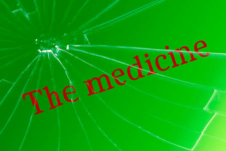 Text medicine on broken glass. The concept of quality medicines Background