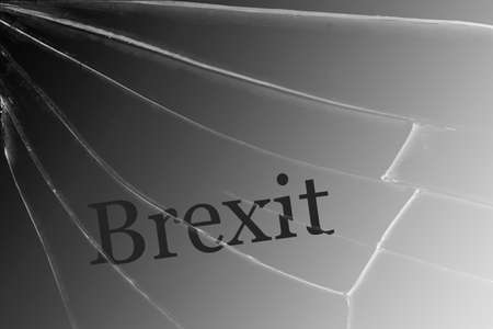 The text Brexit on the broken glass. The concept of a UK exit from the European Union Background 版權商用圖片