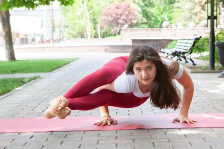 Woman on a yoga mat to relax outdoor. Portrait Banque d'images