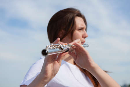 Musicians or beautiful women outdoor. Nature, meditation. Listen to your heart. A flute, unity with nature Portrait