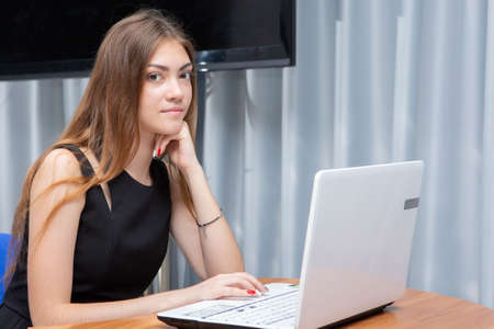 Happy Young Beautiful Woman Using Laptop, Indoors. Portrait