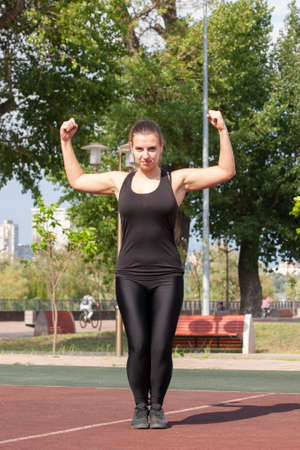 Young sportswoman stretching and preparing to run. Portrait