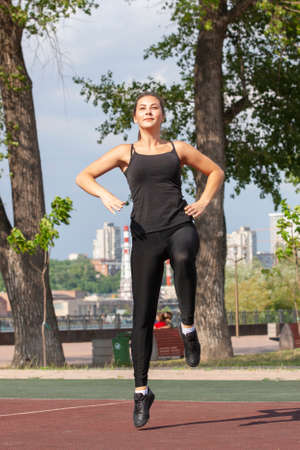 Fit woman exercising outdoors, healthy lifestyle and exercise concept. Pullups