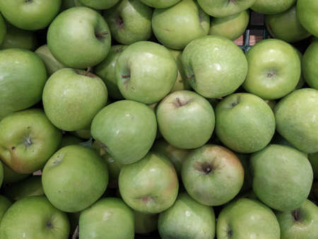 Granny smith green apples. Raw fruit background. Top view. Close-up.