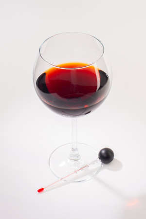 Glass of red wine on a white background and with soft shadow. Close-up Archivio Fotografico - 131857974