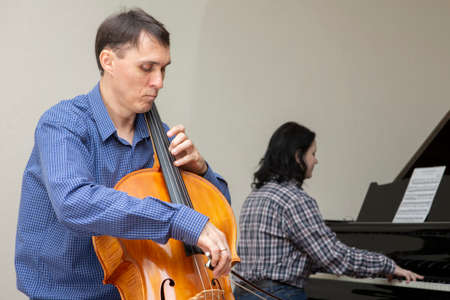 Musicians of the symphony orchestra. Cellist and pianist Portrait.