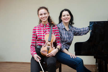 Musicians of the symphony orchestra. Young violinist and pianist. Portrait.