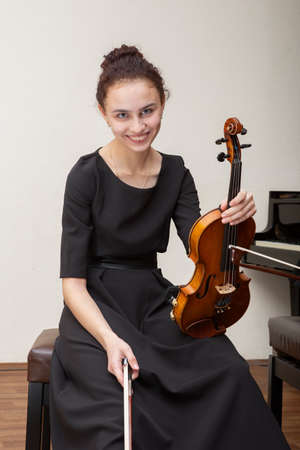 A photo of a young gir playing violin. Portrait.