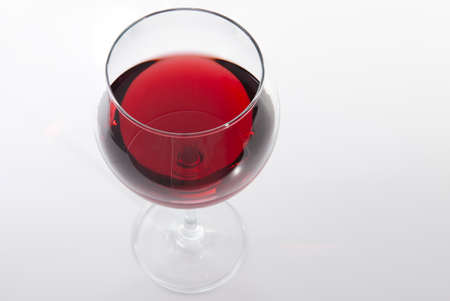 Glass of red wine with shadow.Top view . Close-up