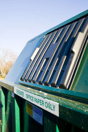 A newspaper and cardboard recycling dumpster. Stok Fotoğraf